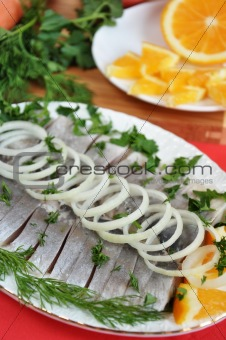 Appetizing herring with onions and oranges