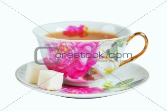 A cup of tea and sugar in isolation on a white background