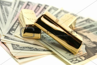 Gold bullion on dollar bills