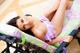 Young Woman Lounging in a Bathing Suit