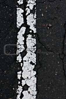 Asphalt road line closeup.