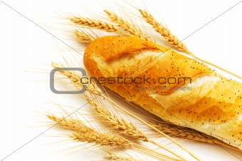Bread and wheat ears isolated on white
