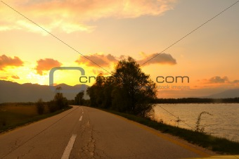 countryroad adventure with beautiful sunset