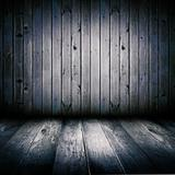 Interior of an old wooden shed, illuminated by the full moon.