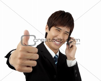 Young business Man With mobile phone and  Thumbs Up