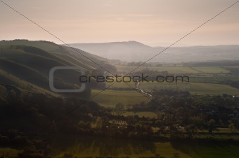 Beautiful warm sunset across rolling countryside landscape