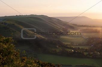 Beautiful warm sunset across rolling countryside landscape