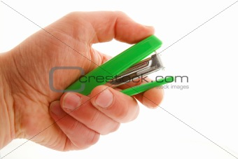 Man's hand with stapler