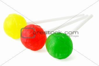 Three colorful lollipops
