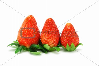 Three red juicy strawberries