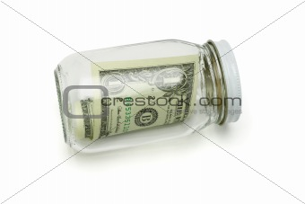 One US dollar in glass jar