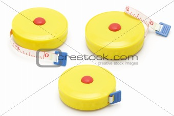 Three yellow plastic measuring tapes