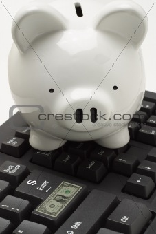 Piggybank on computer keyboard