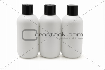 Three white plastic bottles
