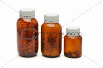 Three glass bottles of medicines