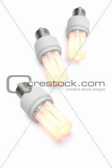 Glowing warm compact fluorescent light bulbs