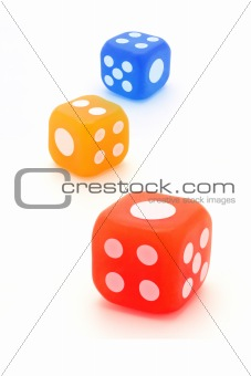 Three colorful rubber dice