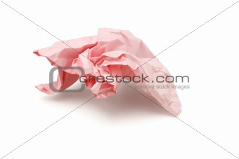 Crumpled pink colored paper