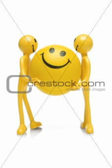 Smiley figurines holding smiley ball