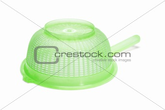 Green plastic kitchen strainer