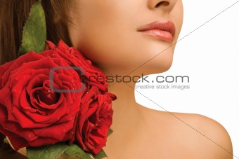 Female shoulder and roses