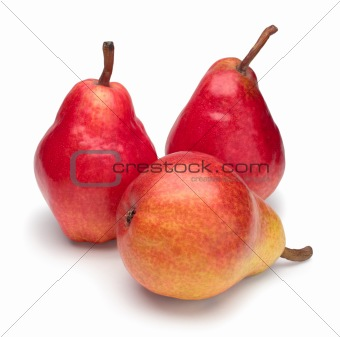 Three red ripe pears on white background.