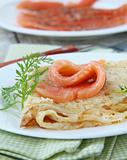 salted salmon red fish with pancakes on a plate