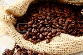 Fresh aromatic coffee beans in a linen bag