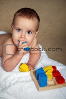 baby with bricks