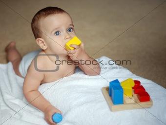 baby with brick
