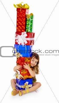 Little girl hugs birthday gifts