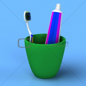 Toothbrush and gel toothpaste in  green cup