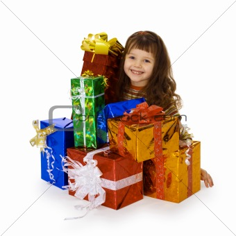 Happy child and big heap of gifts