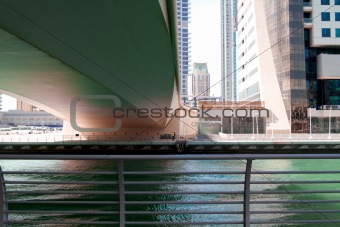 Green reflection under the bridge