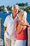 Happy Senior Couple On Vacation By Tropical Sea