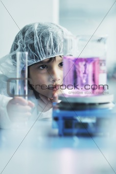 little child scientist in lab