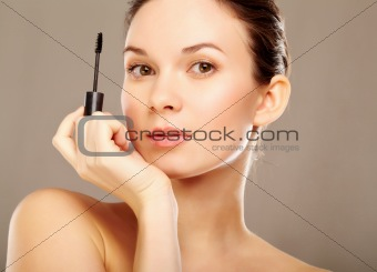 Girl with mascara brush