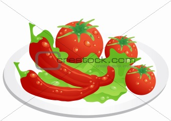 tomato, peppers and lettuce leaves, lying on the kitchen plate