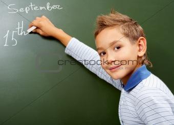 Boy at blackboard