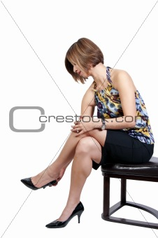 Beautiful Woman Putting on Her Shoes