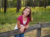 Young Girl on Fence
