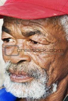 Old African black man with characterful face