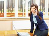 Business woman with phone and PC