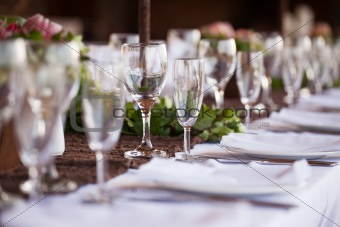 Wine and champagne glasses on table. Selective focus