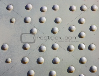 A silver painted metal aircraft background  with  rivets.