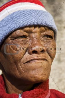 Old African woman against a grunge background