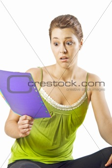Beautiful young woman reading something shocking - white background with space for text