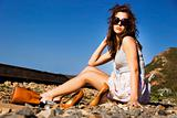 Young model with sunglasses posing