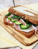Sandwich with ham and pickles on rye bread