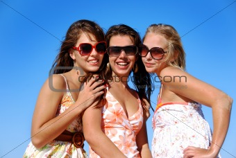 Three young woman having fun on the beach on a summer day